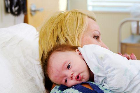 newborn breastfeeding, happy breastfeeding, baby holding the breast while breastfeeding